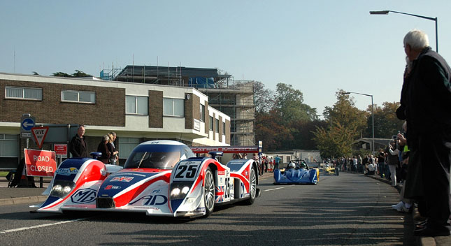 The RML MG Lola EX265C heads the parade through Huntingdon to begin Lola's 50th anniversary celebrations